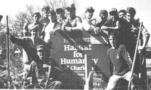Kappa Sigma members standing around sign