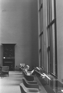 a student studying in front of the windows