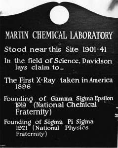 Plaque commemorating original building in which scientific milestones occurred.