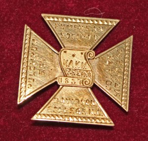 A Eumenean Society badge, which belonged to Joel Mable (class of 1864)