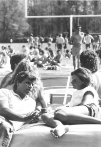 Students frolicing on and around the football field in 1984