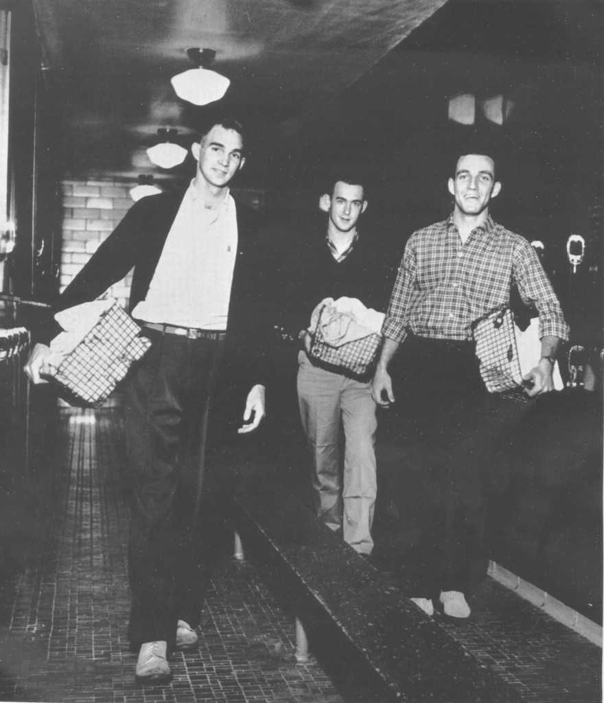 "Students (including future College President John W. Kuykendall, at rear) carry their ""bundles"" to the Laundry, 1957."