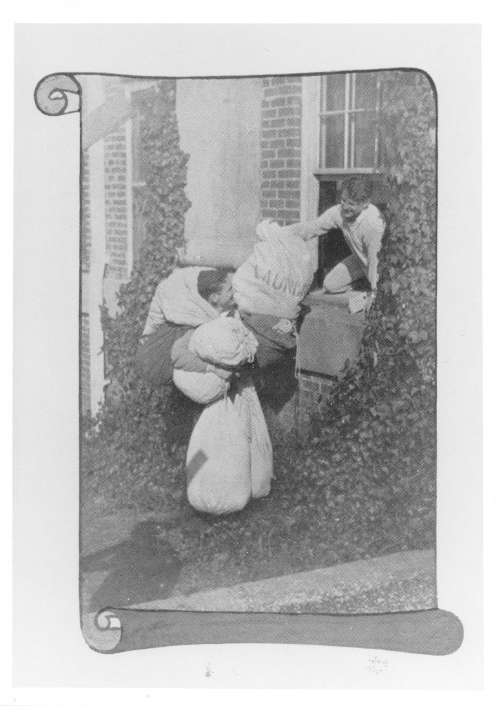 Students holding laundry bags - possibly as part of an entrepreneurial scheme, or else as freshman hazing , 1910.