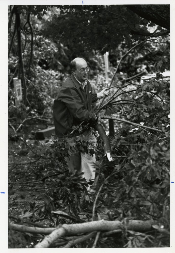 President Kuykendall assisted with the campus clean-up all day on Friday, September 22nd, 1989. He is pictured here carrying branches