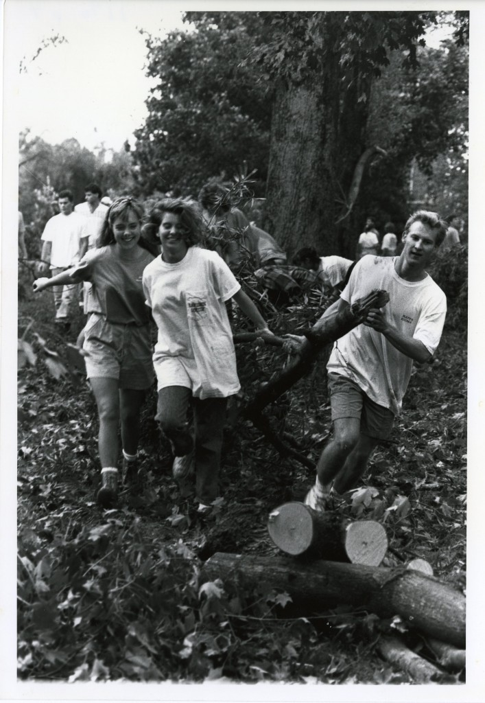 Hilary Coman, Hilary Bridgers, and Blaine John (all Class of 1992), spending their day off from classes helping clean the campus by dragging broken branches