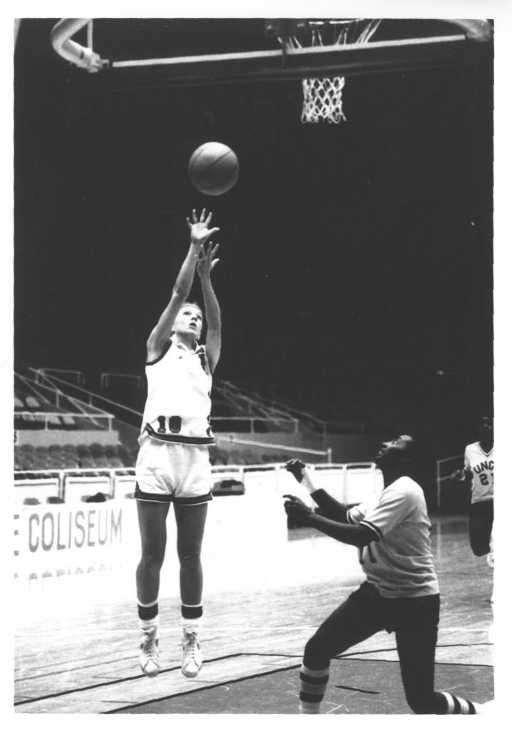 Davidson basketball player makes a jump shot, circa early 1980s.