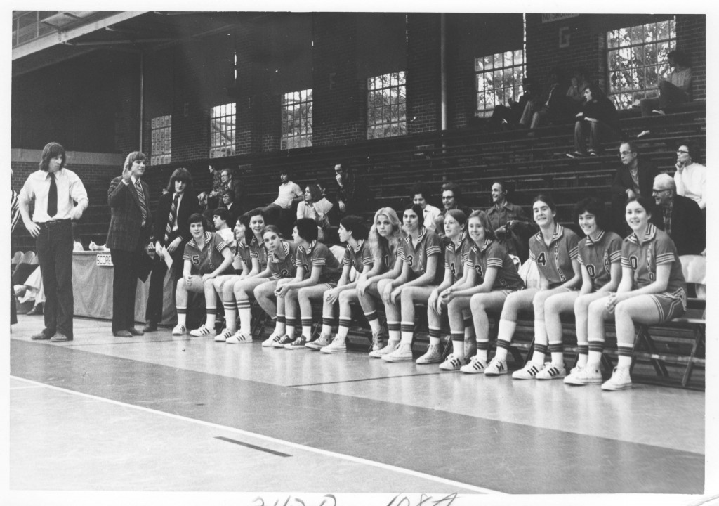 The women's basketball team on the bench during a game in Johnston Gym, circa late 1970s.