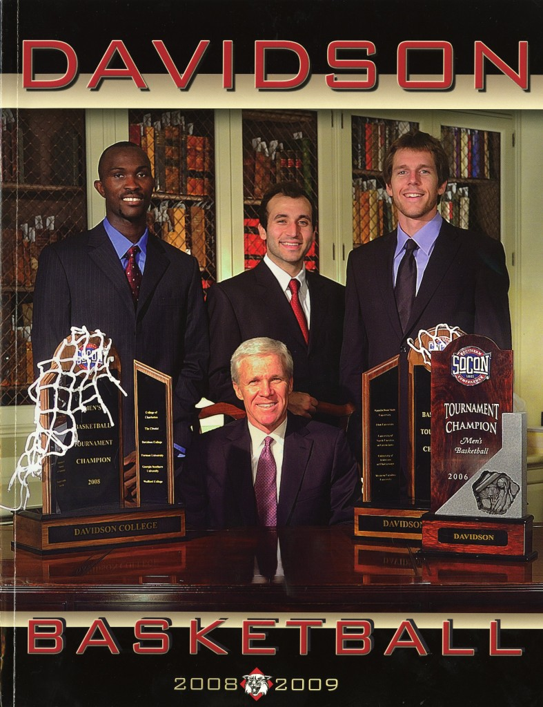 The cover of the 2008 - 2009 basketball media guide, taken in E.H. Little's own Smith Rare Book Room. McKillop is pictured with a few of his SoCon tournament trophies and with then-seniors Andrew Lovedale, Can Civi, and Max Paulhus Gosselin.