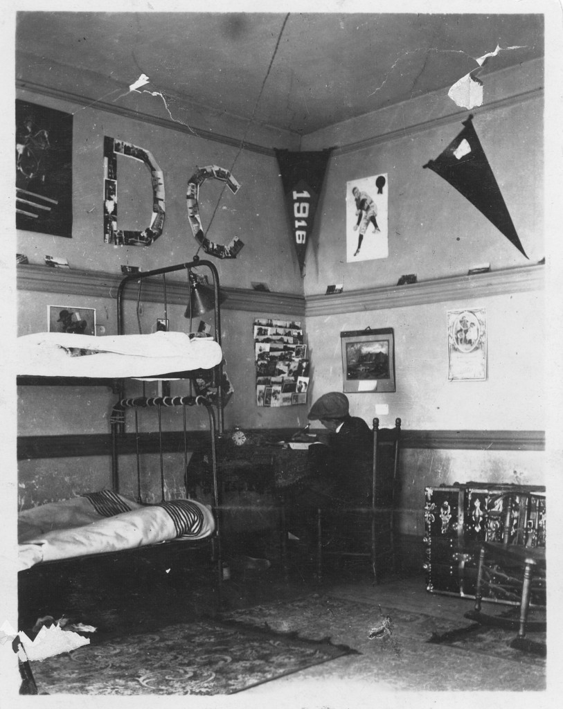 "This picture, courtesy of Robert Hayne Jones (Class of 1916), illustrates what a typical dorm room  in Old Chambers looked like - check out the ""D.C."" constructed of either photographs or postcards."