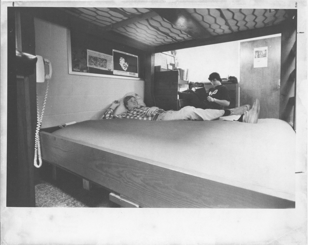Two roommates spend time in their somewhat sparsely decorated dorm room in 1977 (photograph taken by Bill Giduz, Class of 1974). Notice the cameo appearance of Davidson attendee Woodrow Wilson on the wall above the bottom bunk.