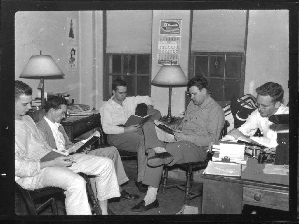 Five students gather in this dorm room in 1947 to do what Davidson students do best - study!
