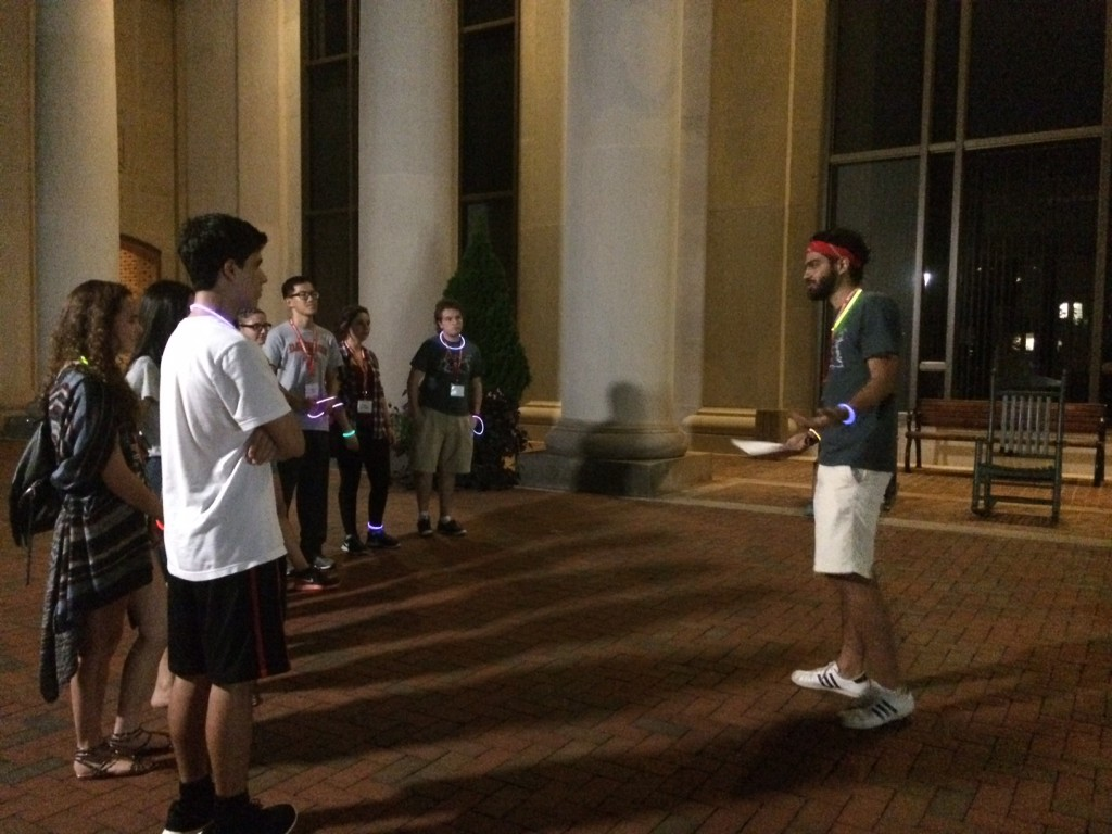 Orientation Leader Santiago Navia (Class of 2017) tells a group of new internationals students the tale of Bill Edwards in front of E.H. Little Library.