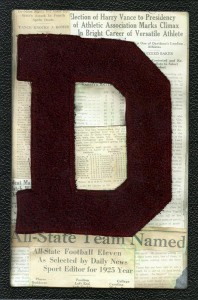 "Vance's varsity ""D"" framed with news clippings about his sports achievements."