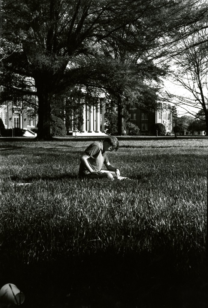 David Johnston (Class of 1990) studies in the grass in front of Chambers Building. Photo by Lucy Silver (Class of 1991).