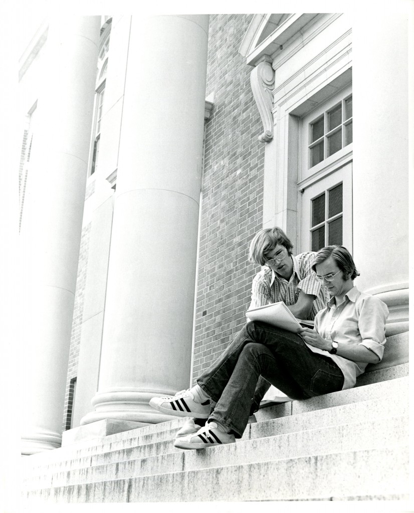 Two students study on the steps of the Grey Library (now Sloan Music Center), 1971.