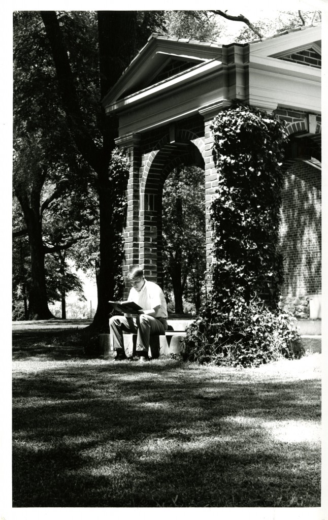 A student studies on the steps of the Old Well.