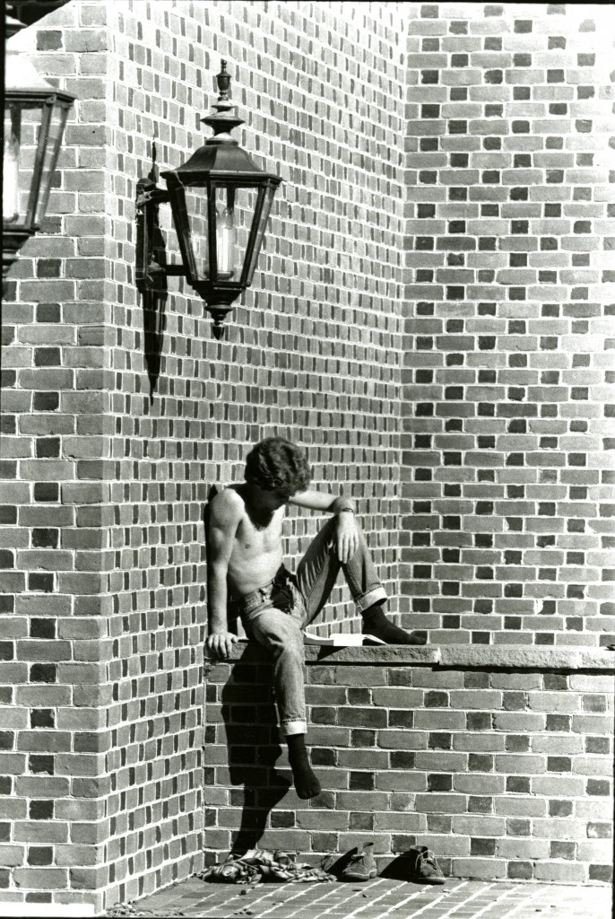 And unknown student studies on a wall outside of E.H. Little Library, during the 1978-79 school year.