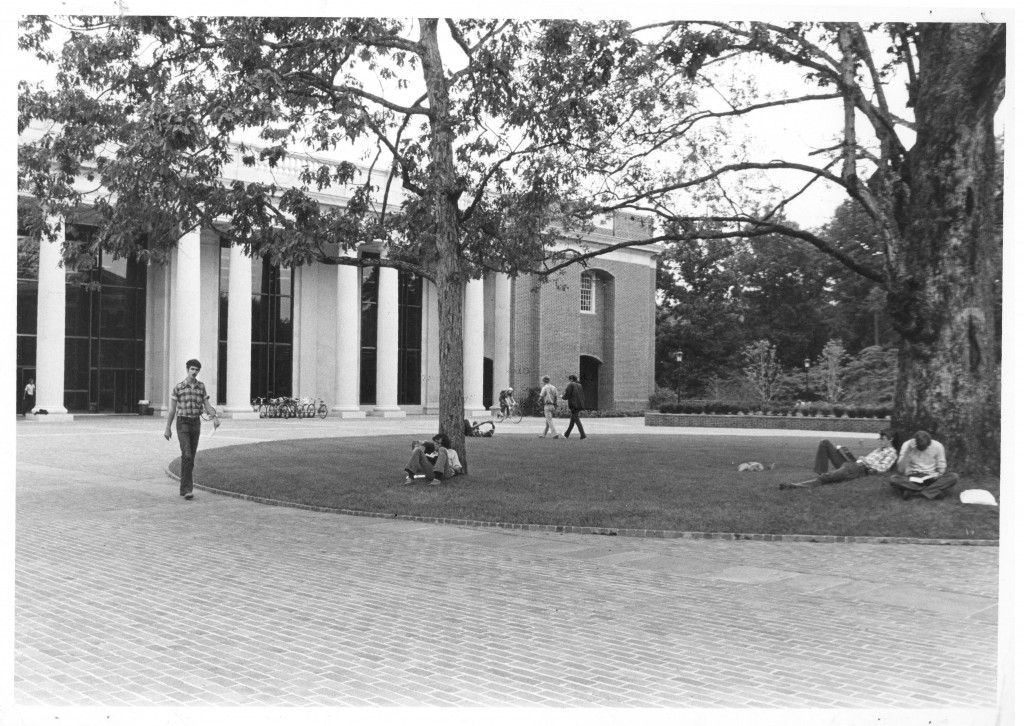 Students study on Richardson Plaza, between E.H. Little Library and Chambers Building, 1975.