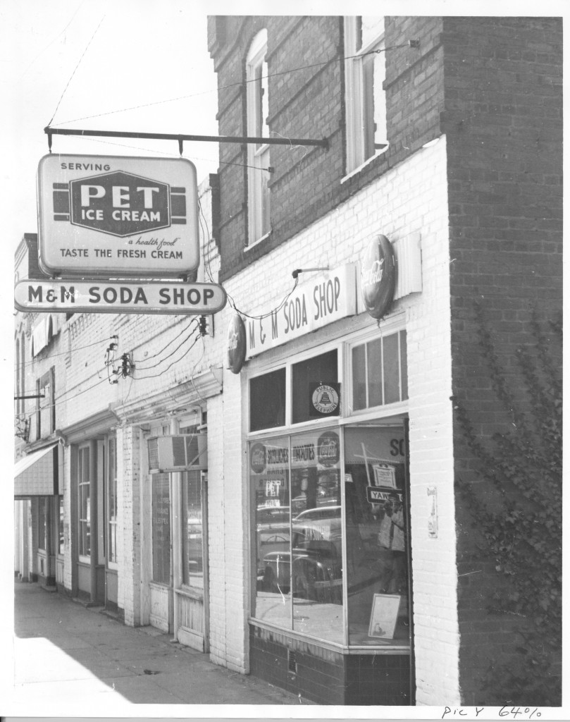 a picture of M&M Soda Shop on Main Street, date unknown.