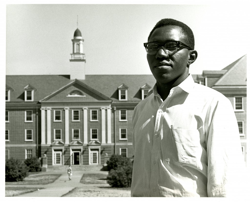 "Publicity shot of Ben Nzengu, 1962. The caption on the back of the photo reads: """"In background Belk Hall, Davidson's largest dormitory. Ben lives on the 4th floor with J. Knox Abernethy, Jr., a senior and son of Rev. J.K. Abernethy…"""