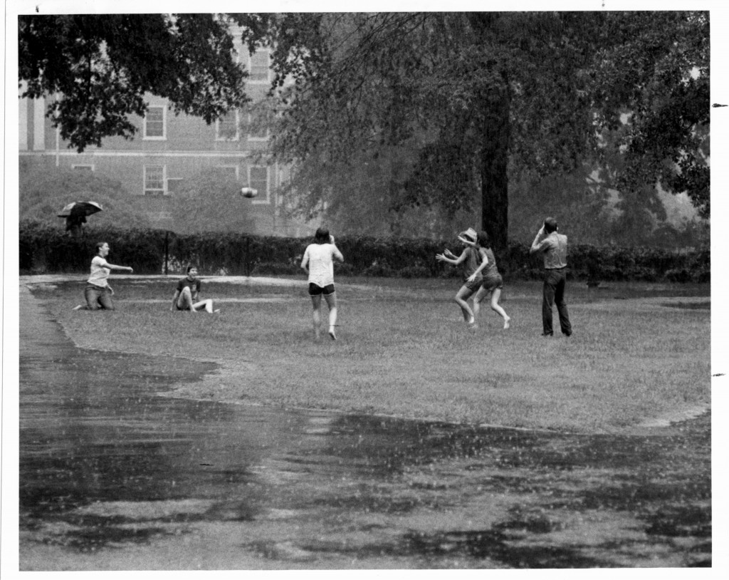 "Davidson students play fickerball even in the rain! The caption on the reverse of this photograph reads: ""Social life. Flickerball in rain, Sept. '77."""