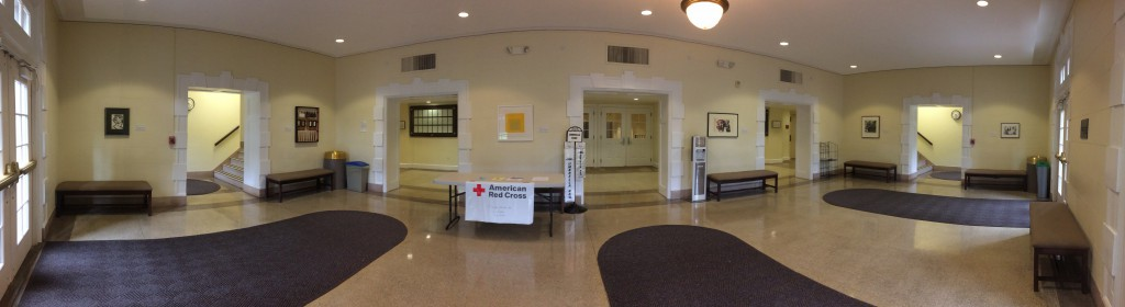 A panoramic shot of the lobby of Chambers during the Archives Month Art Show.