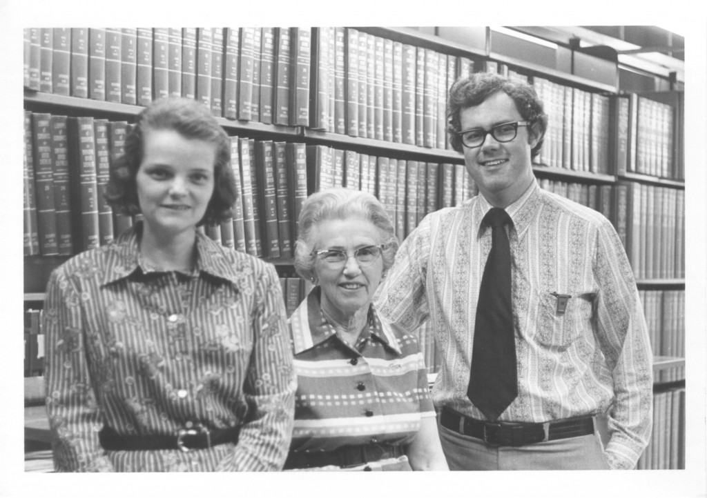 """Dr. Beaty, Ms. , and Dr. Park stand together in front of book Stacks in Grey Memorial Library."" Circa 1972"