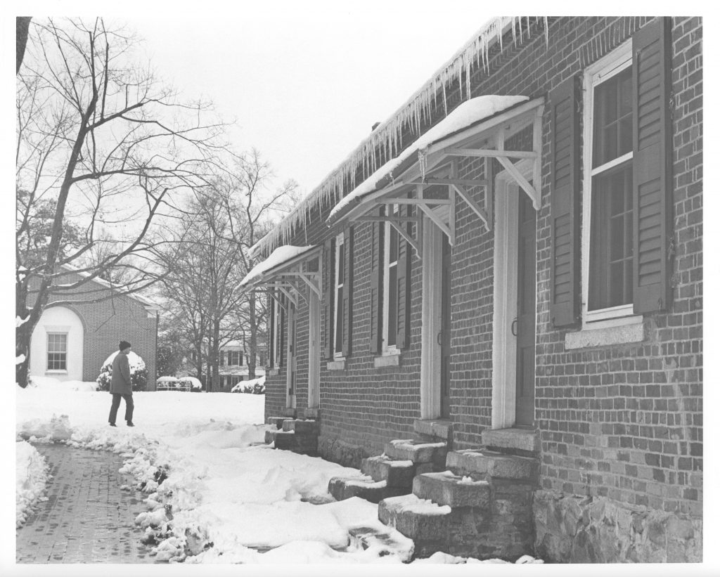 A student walks near Elm Row, December 1971.
