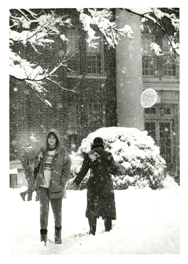 Two students walk near Chambers in the snow, 1987.