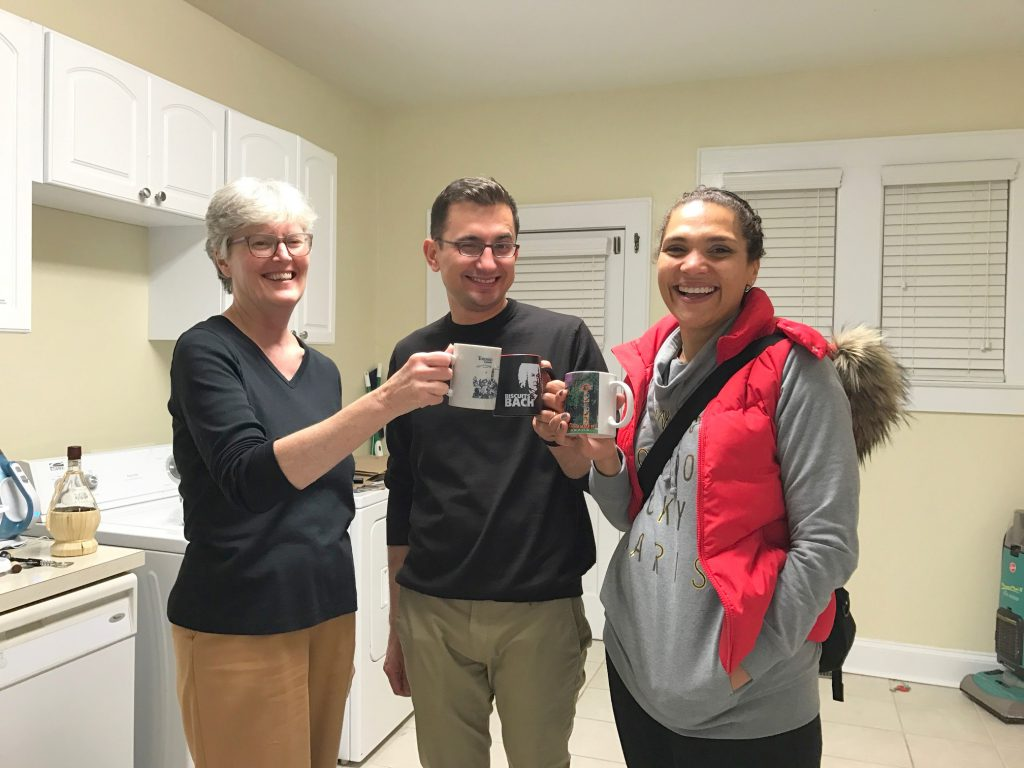 Jan Blodgett (College Archivists and Records Management Coordinator), Roman Utkin (Assistant Professor of Russian Studies), and Caroline Fache (Associate Professor of French & Francophone Studies) enjoy the archival glogg.