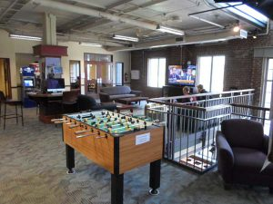 Alvarez Union lounge area with a foosball table