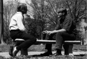 Tom Shandley with SGA President Warren Buford on a bench outside