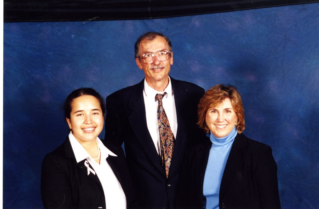Bill Giduz and Meg Kimmel stand with a student at the Belk Scholarship Awards Ceremony in 2000.