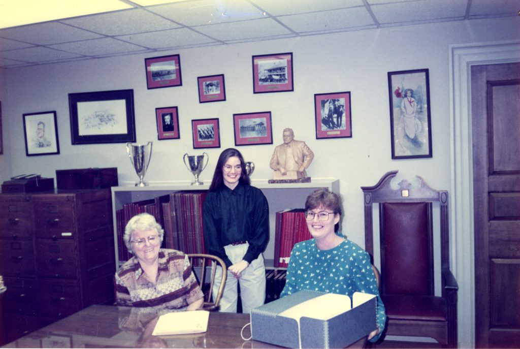 Jan sits at a table in the archives in 1994, with Loyce Davis and Barbara Butler.