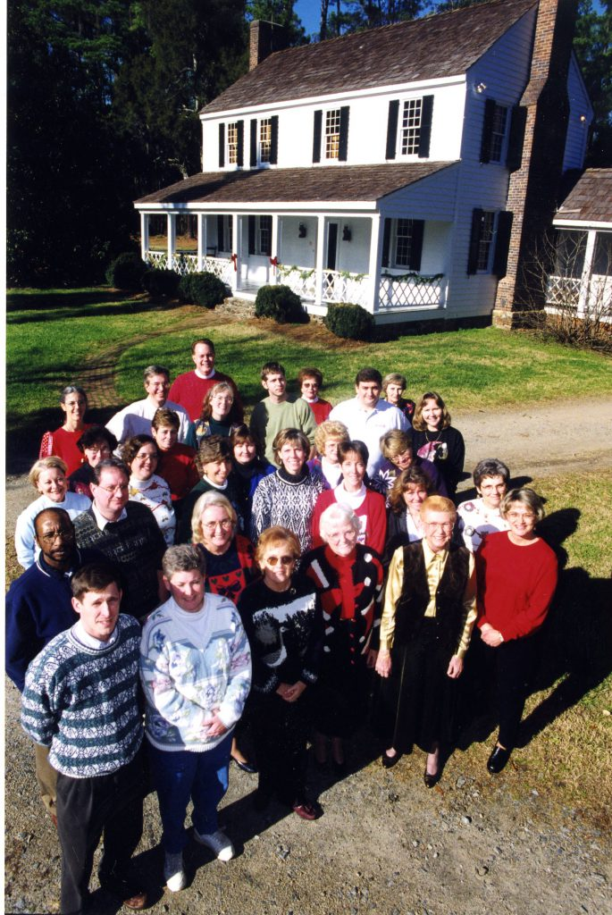Library staff gather in front of Beaver Dam in 1999. Jan is towards the back of the group.