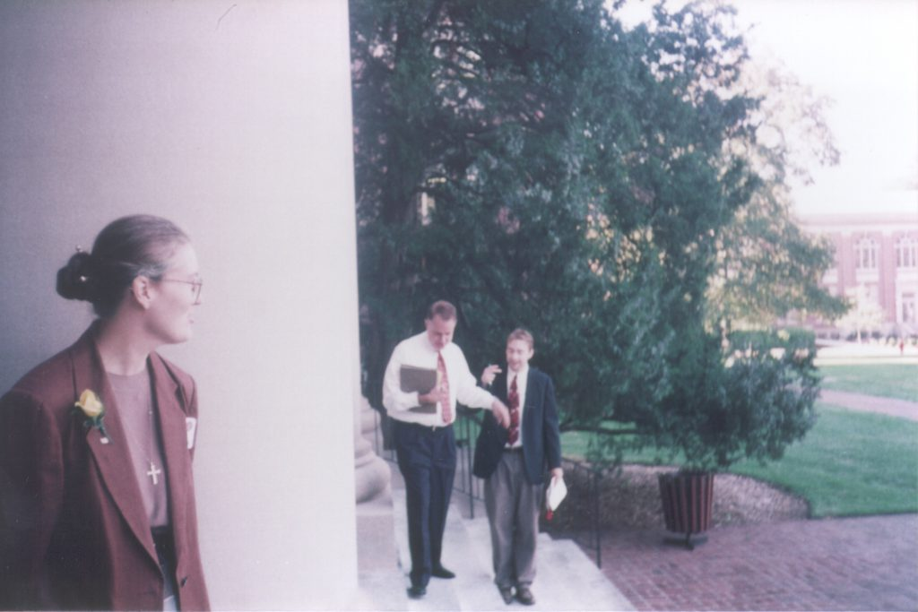 Jan stands by one of the columns of the Chambers Building in 1997, while then Library Director Leland Park chats with Josh Gaffga.