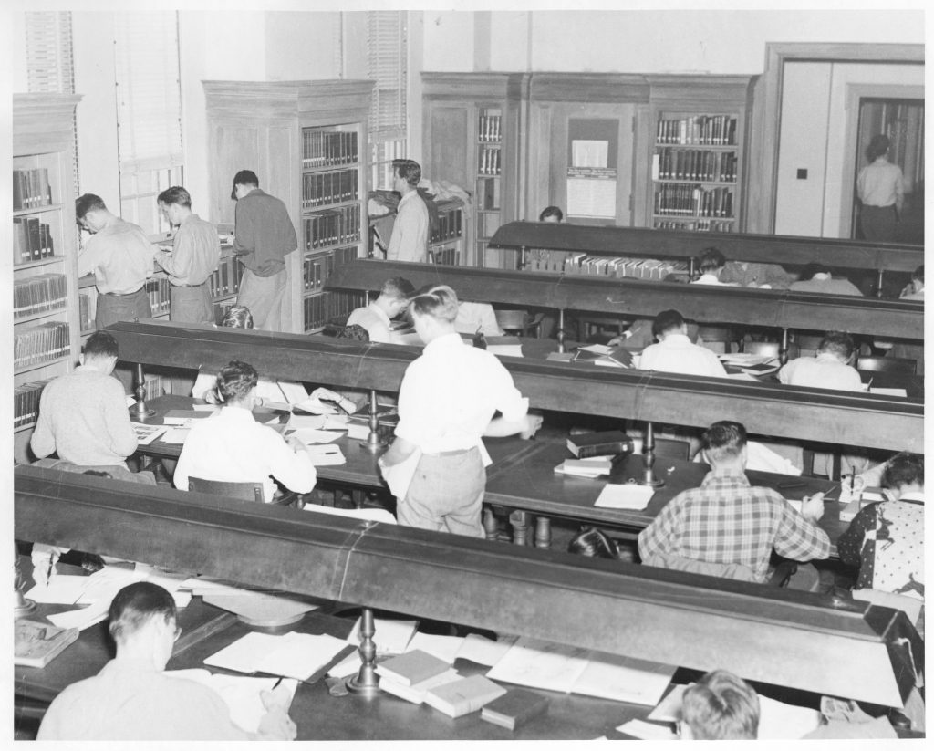Many students studying in the reading room of Grey Library, circa 1960