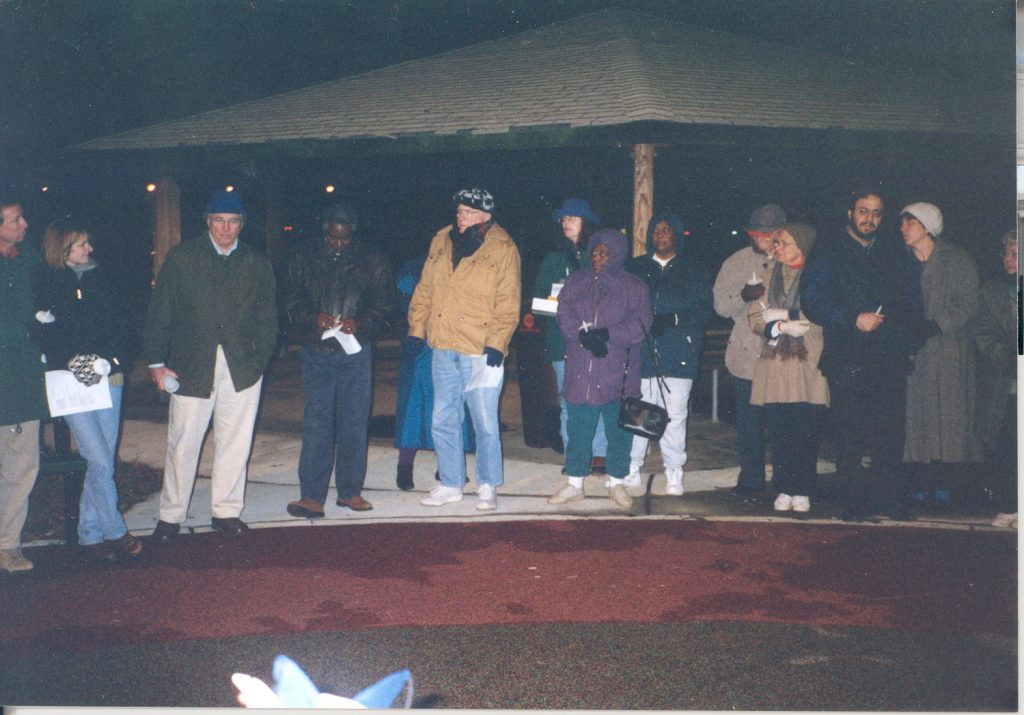 Members of Common Ground, including Jan, a local grassroots organization designed promote communication and understanding and improve relations among people of all races in Davidson, gather for a Christmas Day memorial service in 1998.