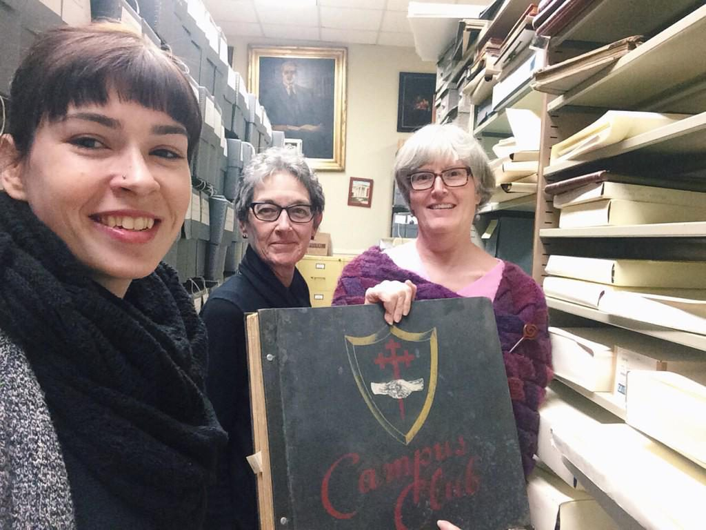 "A full Archives & Special Collections staff #shelfie (a picture in which the photo is taken using the front camera on a phone, in this case a ""shelfie"" because they are next the shelves) in 2015! From right to left: Caitlin Christian-Lamb (me!), Sharon Byrd, and Jan Blodgett."