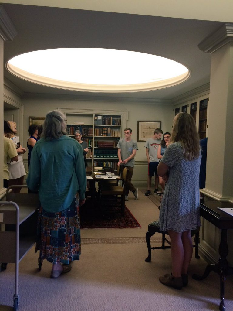 Jan (with her back to the camera) works with ENV 340 students in the Rare Book Room, in 2016.