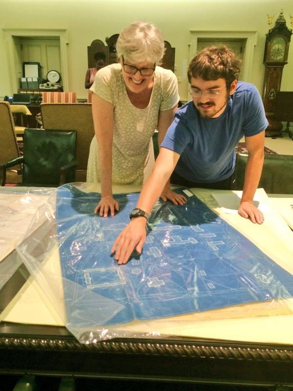 Jan works with a student on researching campus architecture, looking at a blueprint in the Rare Book Room in 2014.