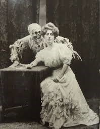 Ghost-like skeleton behind 19thc woman in period dress