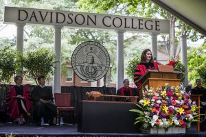 Commencement 2018 showing mace on its stand on the dais with President Quillen