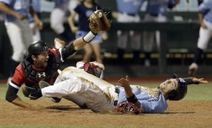 Davidson baseball game, image of the Davidson catcher diving to tag out a U.N.C. Chapel Hill runner at home plate.