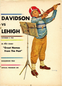 A boy wearing a football helmet playing a violin. Davidson vs. Lehigh. Richardson Field. November 9, 1953.