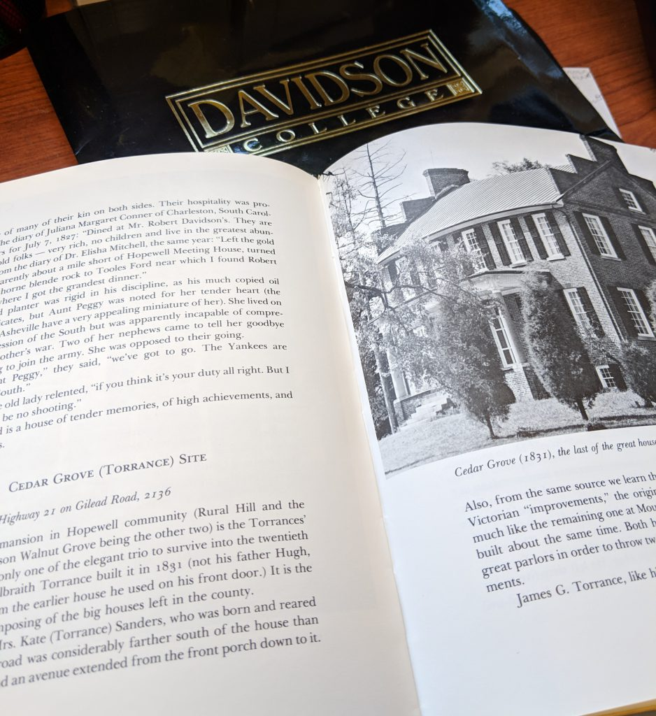 "Image of two pages of text from ""Plantation World Around Davidson."" The right page features a two story brick home, also known as ""Cedar Grove."""