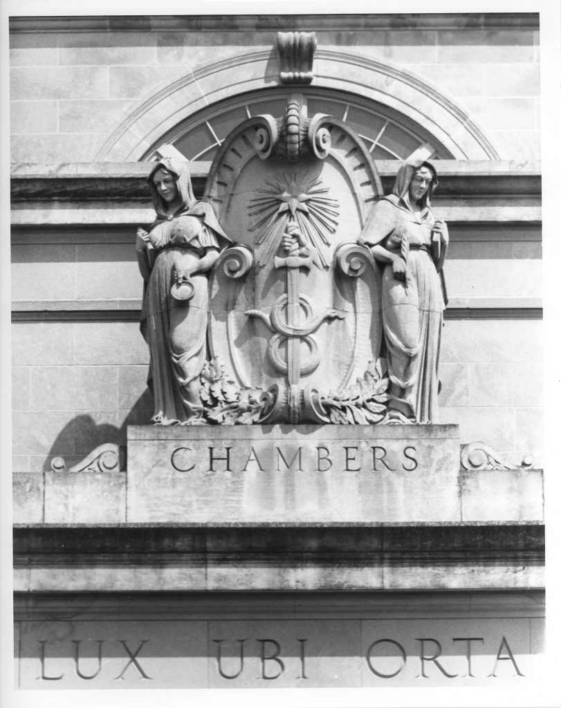 B/W image of two statues on the top of Chambersg